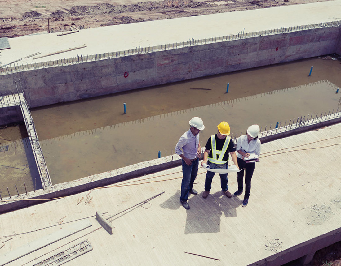 Engineers and Consultants on site reviewing plans, Blend ESQ Consulting